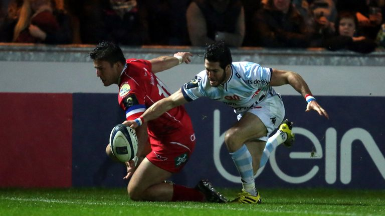 Maxime Machenaud of Racing 92 beats Scarlets wing DTH Van Der Merwe to the ball to score