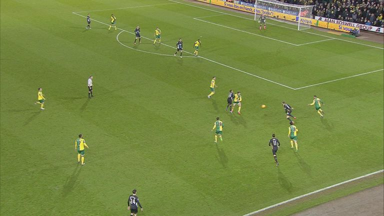Arsenal's Santi Cazorla is booked for simulation after a challenge from Norwich's Jonny Howson
