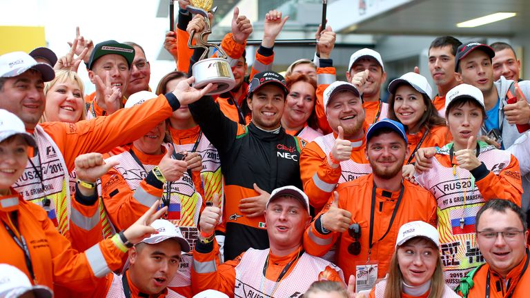 The Force Awakens: Sergio Perez celebrates with the marshals in Sochi after finishing a stunning third - Picture by Mark Thompson, Getty Images