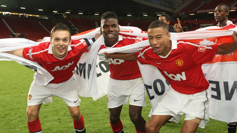 Tom Thorpe (left) celebrates with then team-mates Paul Pogba (middle) and Jesse Lingard (right) in 2011