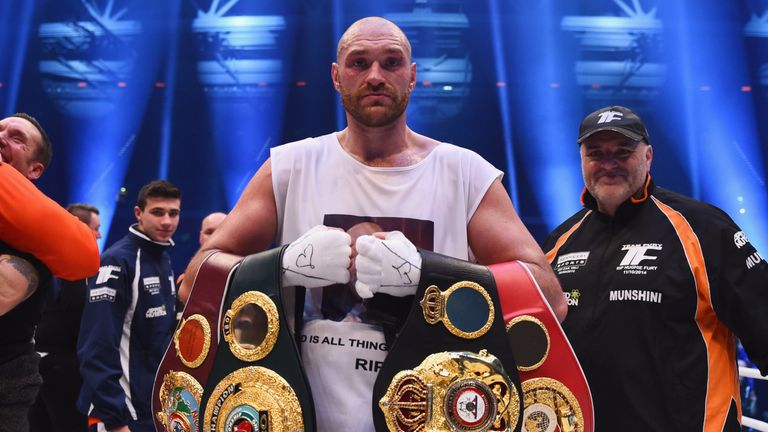 Tyson Fury celebrates with his belts after defeating Wladimir Klitschko - but the IBF one is now up for grabs