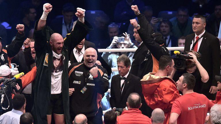 Tyson Fury celebrates after winning his fight against Wladimir Klitschko