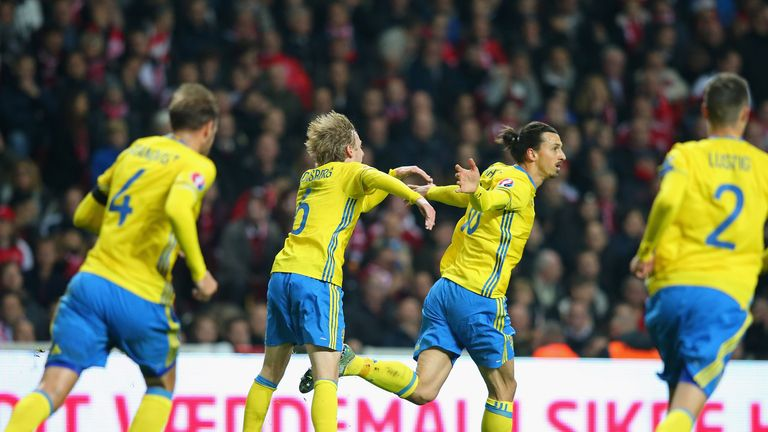 Zlatan Ibrahimovic (second right) of Sweden celebrates after scoring the opening goal