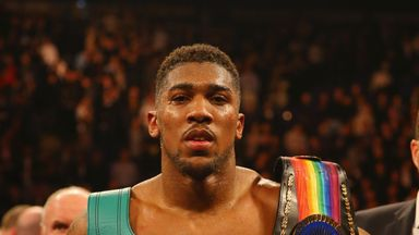 Anthony Joshua celebrates with the British and Commonwealth belts after beating Dillian Whyte