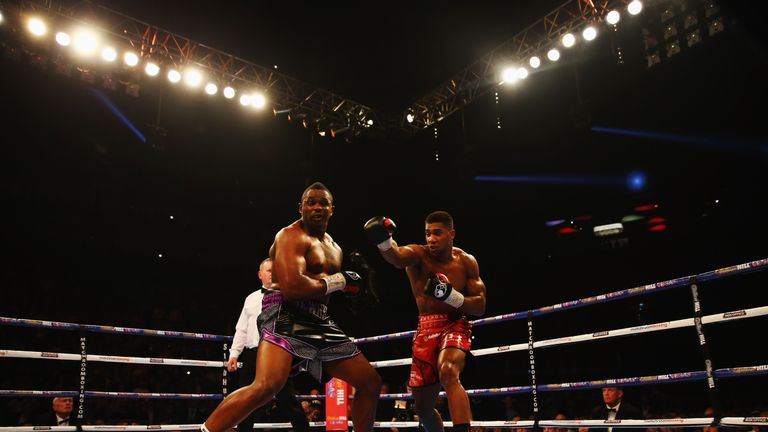 Whyte (left) withstood Joshua's power for long periods