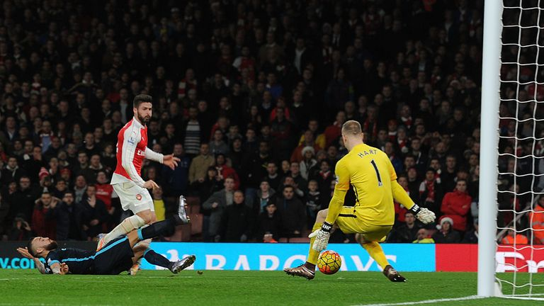 Giroud shoots past Man City goalkeeper Joe Hart to score Arsenal's second goal in first-half injury-time