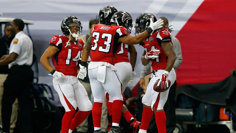 The Falcons celebrate a touchdown during their upset of the Panthers