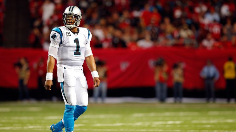 Quarterback Cam Newton looks dejected as Carolina's perfect season ends in Atlanta