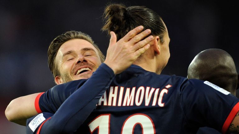 Ibrahimovic celebrates a goal with Beckham after scoring for PSG