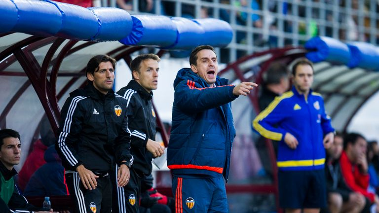 Neville (middle) is happy with the effort and desire of his players