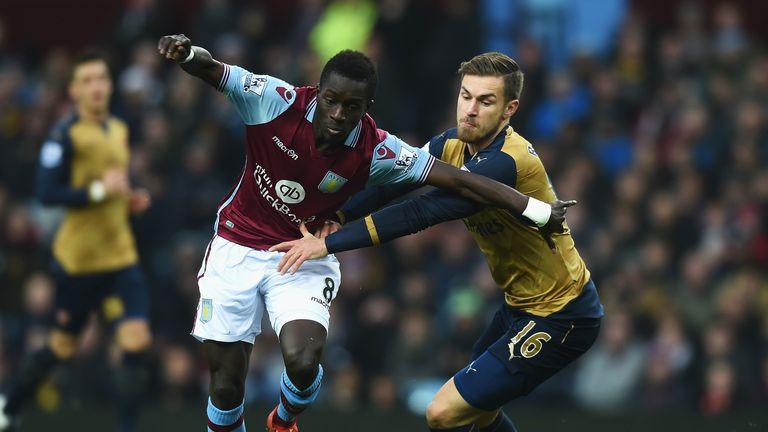 Idrissa Gueye holds off  Ramsey at Villa Park