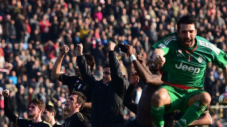 Juventus players celebrate their win at Carpi