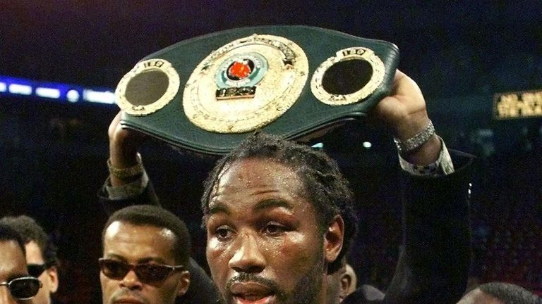 Lennox Lewis fought to a split draw with Evander Holyfield