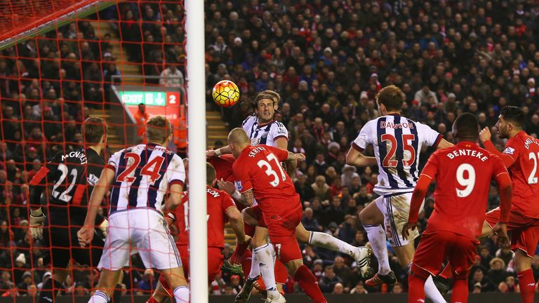 Jonas Olsson puts West Brom ahead with a second-half header against Liverpool