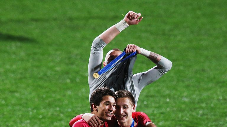 Grujic (left) celebrates after winning the U20 World Cup with Serbia