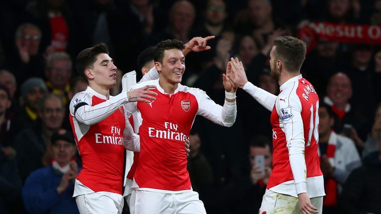 Mesut Ozil of Arsenal celebrates scoring his team's second goal against Bournemouth