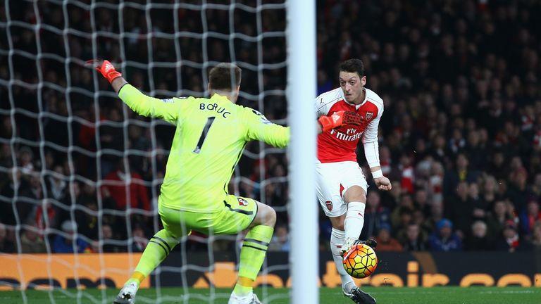 Mesut Ozil slots past Artur Boruc to put Arsenal 2-0 up against Bournemouth