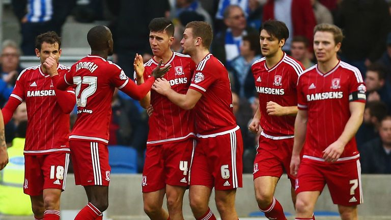 Albert Adomah of Middlesbrough celebrates with Daniel Ayala and team-mates