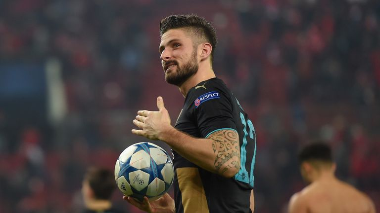 Arsenal hat-trick hero Olivier Giroud celebrates at the final whistle in Pireaus
