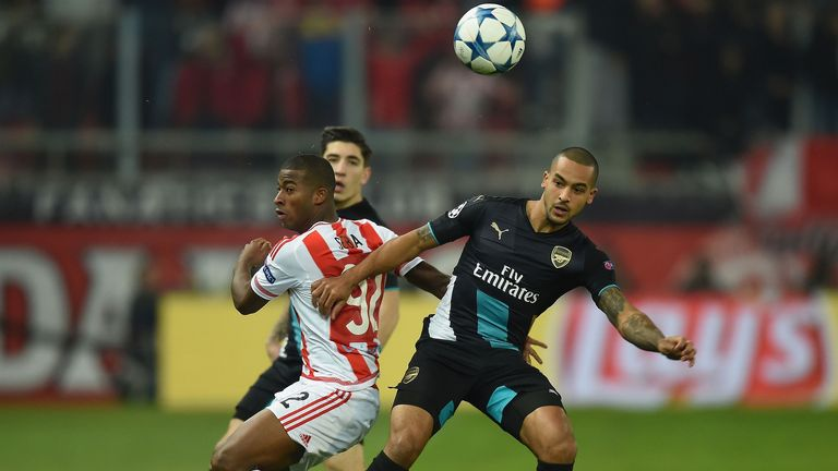 Theo Walcott competes for possession