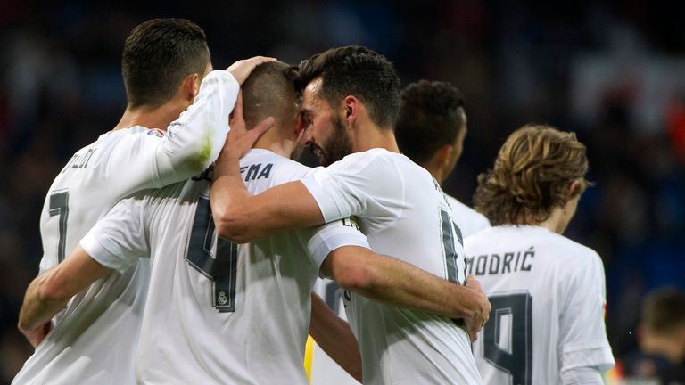Karim Benzema celebrates with team-mates after scoring
