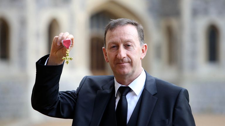 Swansea City chairman Huw Jenkins collected an OBE on Tuesday