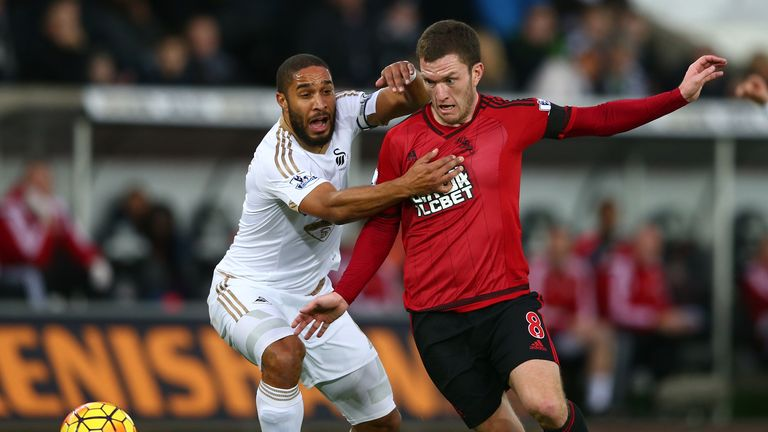Craig Gardner (right) and Ashley Williams tussle for possession