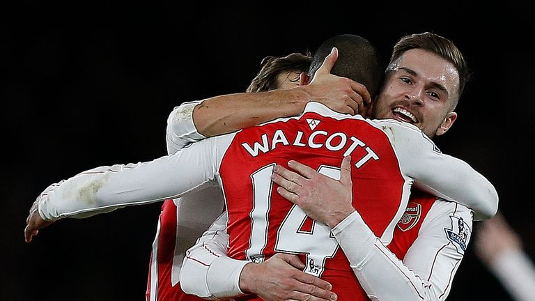 Theo Walcott (C) celebrates with Ramsey (R) after scoring Arsenal's first goal