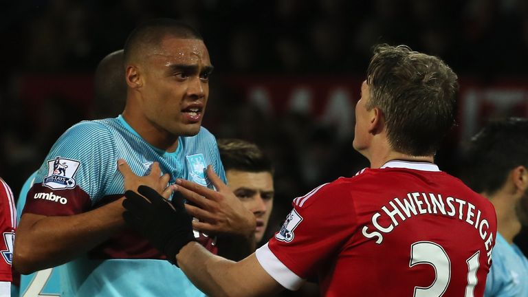 Bastian Schweinsteiger (right) clashes with Winston Reid at Old Trafford