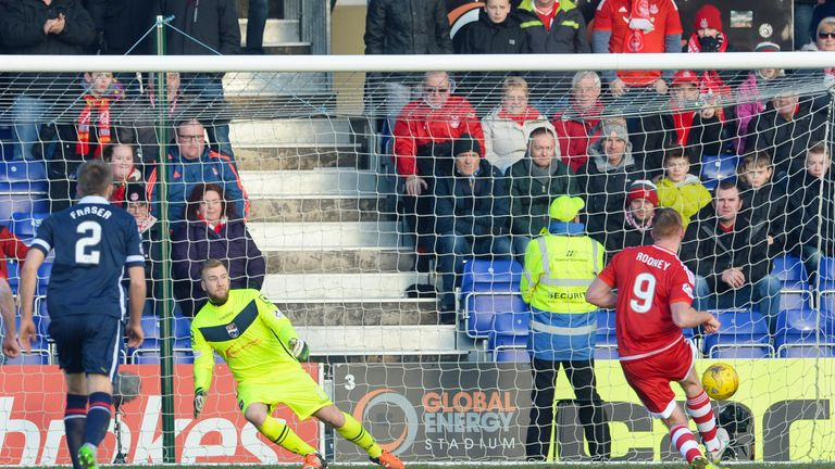 Adam Rooney (right) scores from the spot to draw Aberdeen level