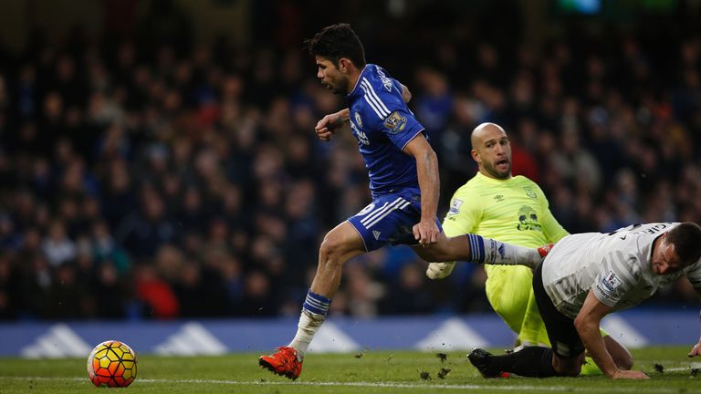 Diego Costa goes around Everton's goalkeeper Tim Howard to pull a goal back for Chelsea
