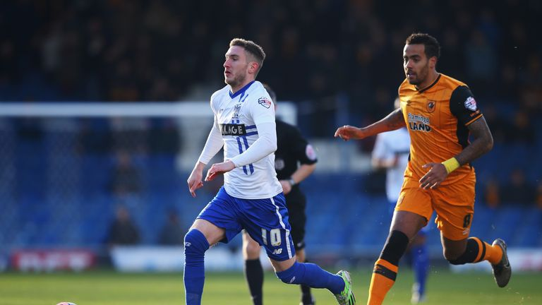 Danny Mayor of Bury and Tom Huddlestone of Hull compete for the ball