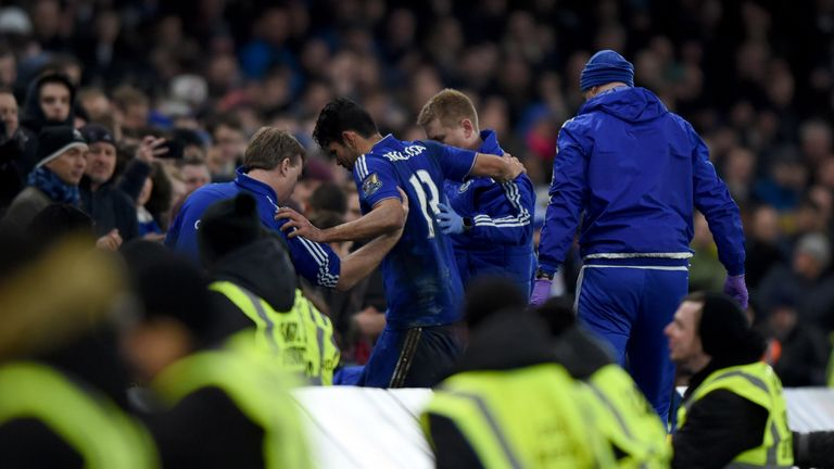 Chelsea's Diego Costa is helped from the field