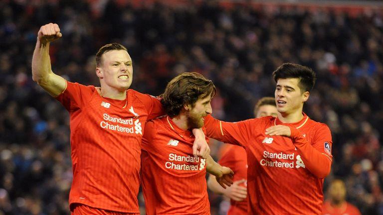 Joe Allen (C) of Liverpool is congratulated after scoring the opener