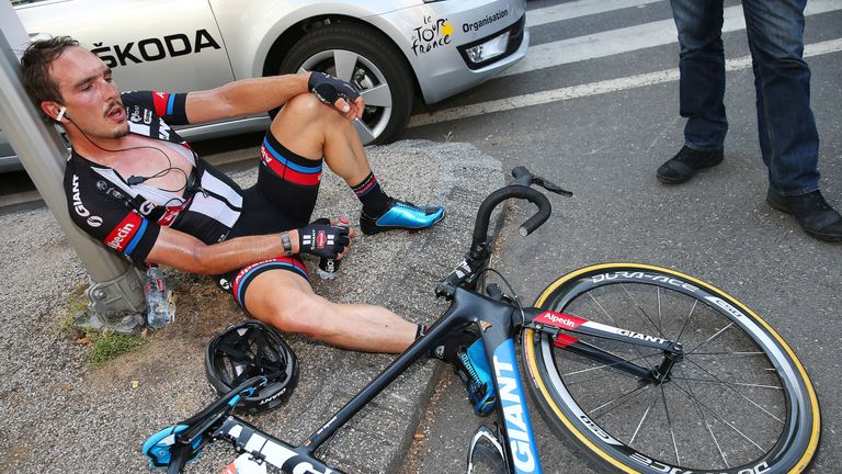 John Degenkolb rests on the pavement during last year's Tour de France