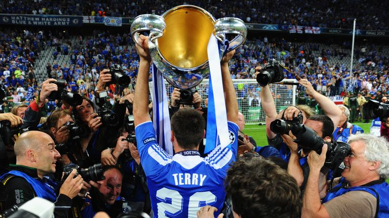 Terry lifts the Champions League trophy in 2012 after missing the final