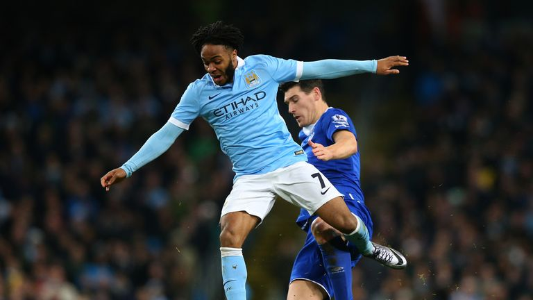 Raheem Sterling of Manchester City is tackled by Gareth Barry of Everton