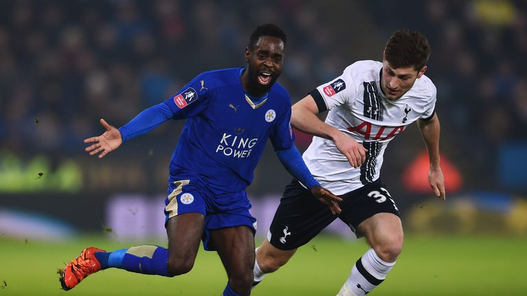Nathan Dyer is pulled back by Ben Davies