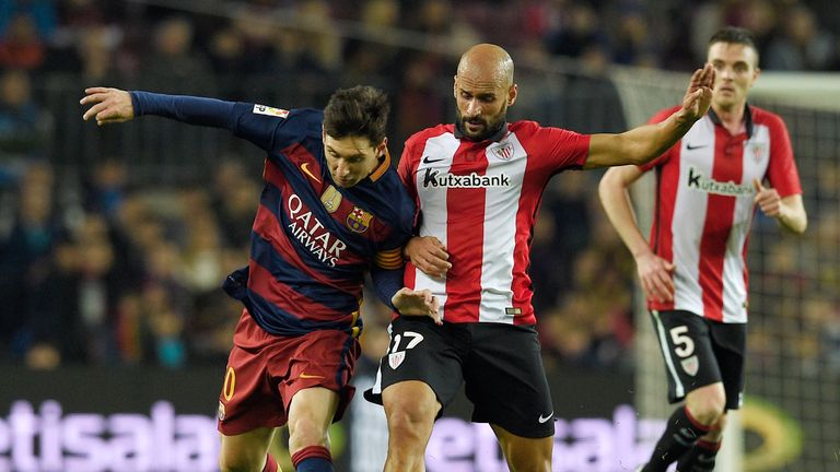 Lionel Messi (left) is challenged by Mikel Rico at the Nou Camp