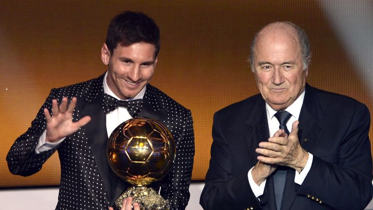 Lionel Messi receiving the Ballon d'Or trophy in 2013