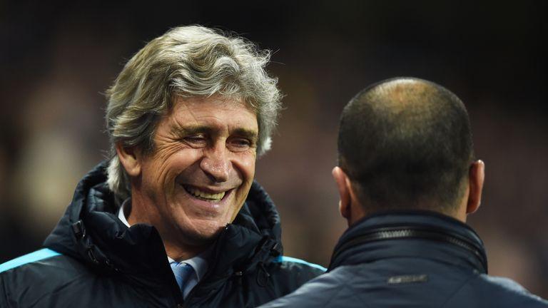 Manchester City boss Manuel Pellegrini greets Roberto Martinez