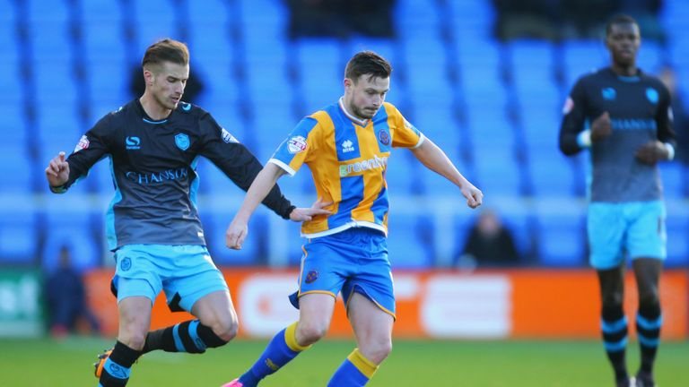 Michael Turner of Sheffield Wednesday and Andrew Mangan of Shrewsbury Town compete for the ball