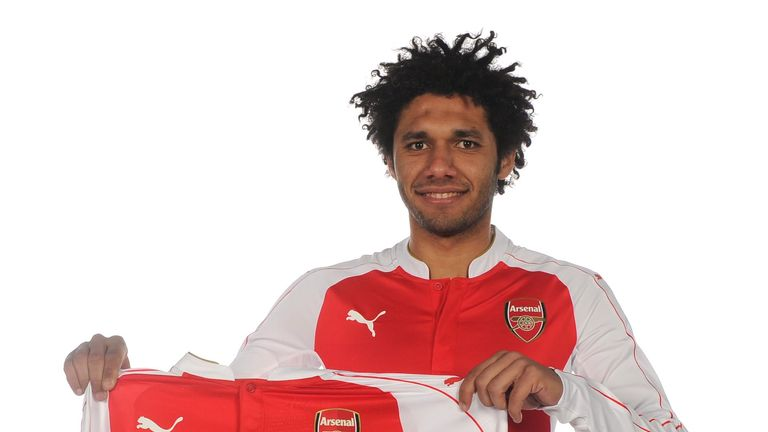 Mohamed Elneny poses with the Arsenal shirt after his arrival from Basel
