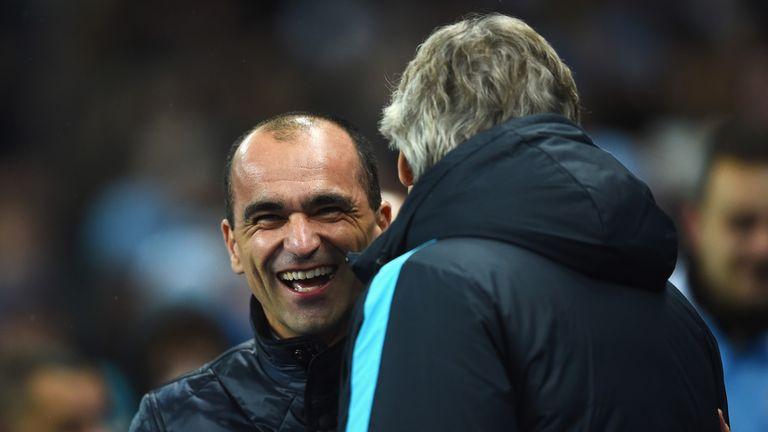 Roberto Martinez and Manuel Pellegrini share a joke.