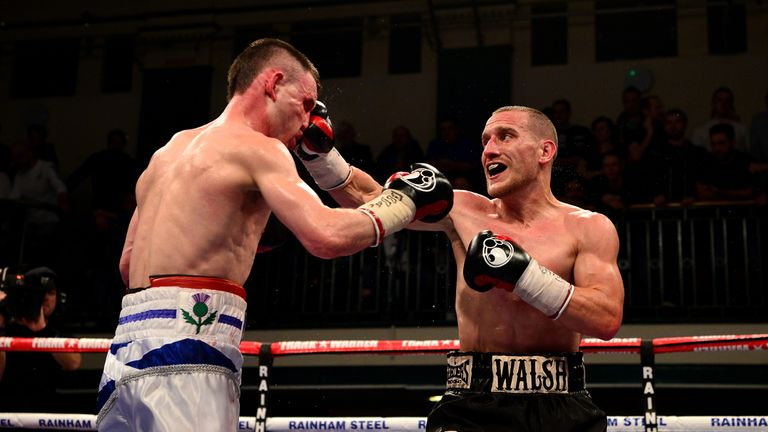Ryan Walsh lands a right on Darren Traynor during their British Feathwerweight Championship Contest  at York Hall