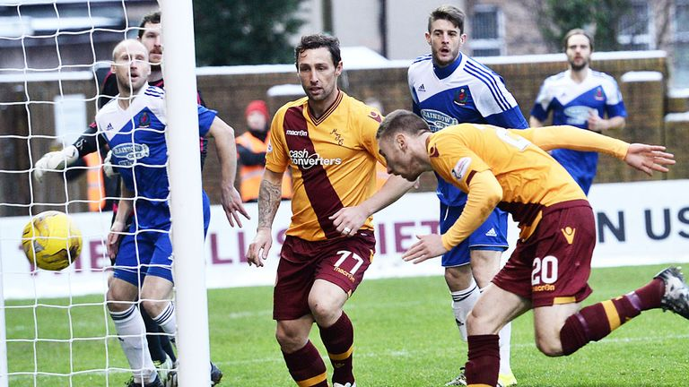 Scott McDonald looks on as Louis Moult stoops to score Motherwell's first goal