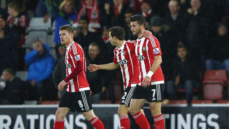 Shane Long (right) celebrates scoring Southampton's first goal against Watford