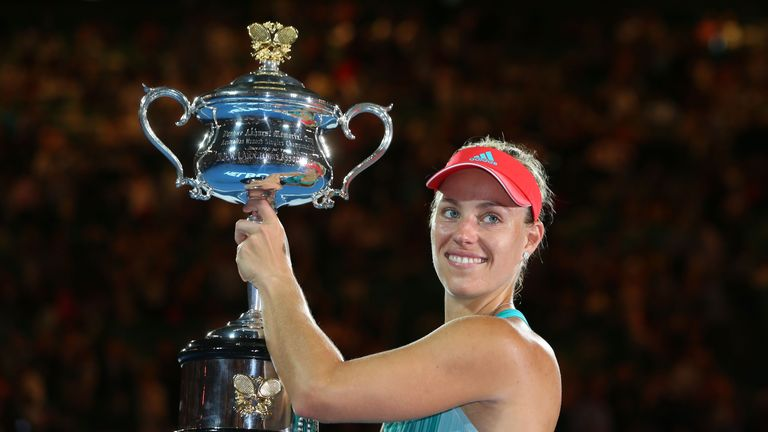 Kerber poses with the trophy after beating Williams