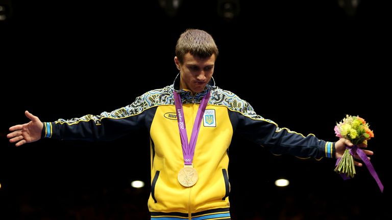 Vasyl Lomachenko  celebrates on the podium during the medal ceremony in London 2012