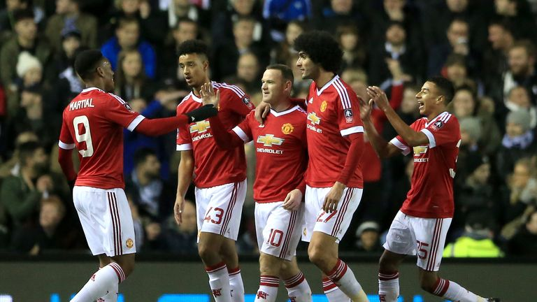 Manchester United's Wayne Rooney (centre) celebrates after opening the scoring from 18 yards
